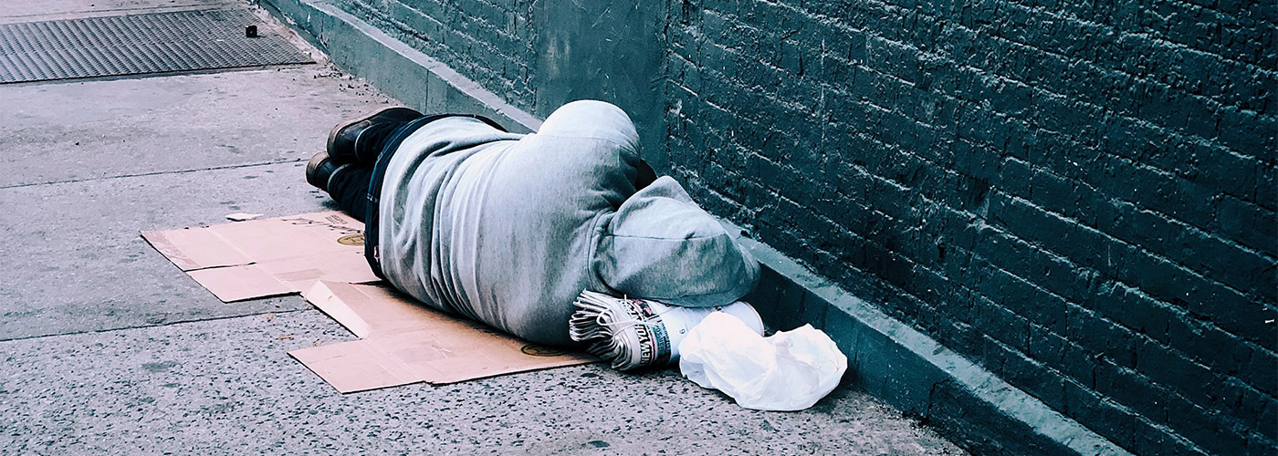 Homeless person sleeping on a street